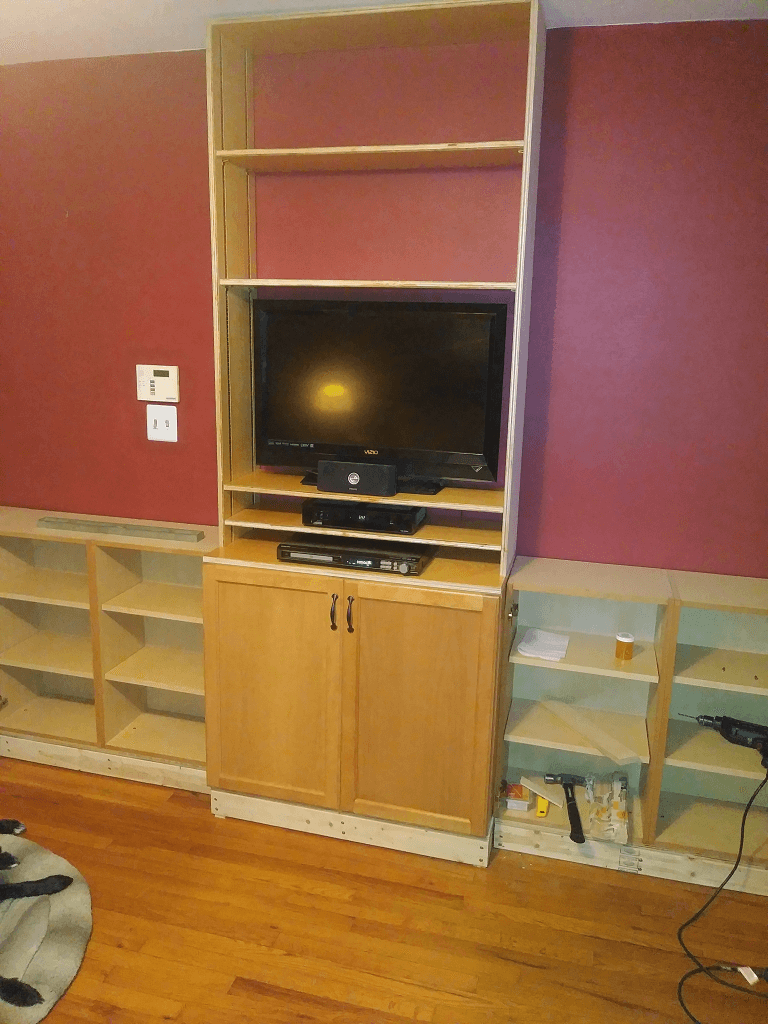 Center doors and cabinet shelves installed.