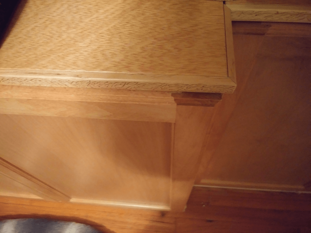 Cabinet top trim installed.