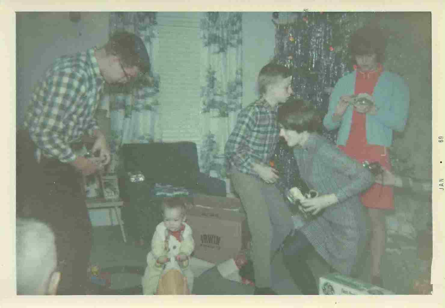 My 1st Christmas, with Dad, Uncle Doug, Aunt Sharon, and Aunt Carolyn